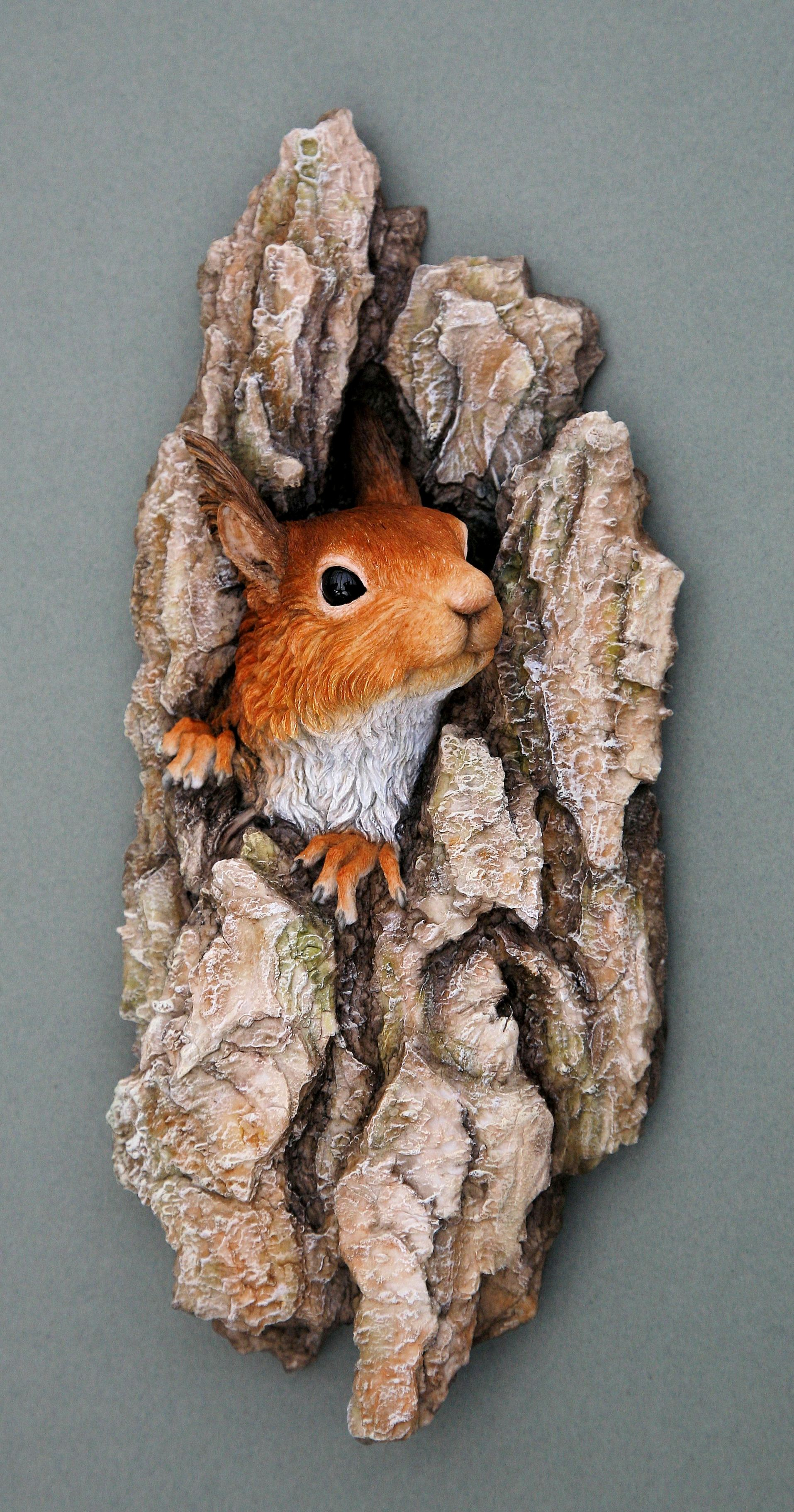 Red squirrel wall plaque in sculpted relief by sculptor Kirsty Armstrong